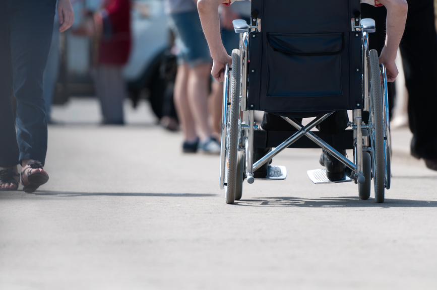 Disabled man on wheelchair.